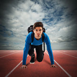 Student sprinter. Teenager boy with backpack ready to run Stock Photos