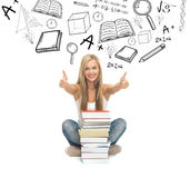 Student with stack of books. Education and school concept - picture of smiling student with stack of books Royalty Free Stock Photo