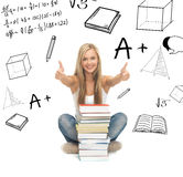 Student with stack of books Royalty Free Stock Images