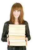 Student with a stack of books Royalty Free Stock Image