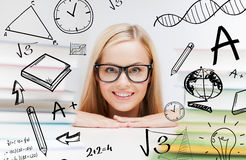 Student with stack of books and doodles Royalty Free Stock Photo