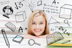 Student with stack of books and doodles Royalty Free Stock Images