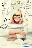 Student with stack of books and doodles Royalty Free Stock Photos