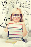 Student with stack of books and doodles Stock Image