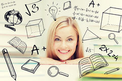 Student with stack of books and doodles Stock Photography