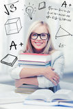 Student with stack of books and doodles Royalty Free Stock Photography