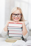 Student with stack of books. Picture of smiling student with stack of books Stock Photography