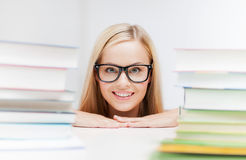 Student with stack of books Stock Photo