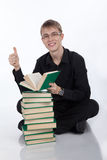 Student with a stack of books on white background Stock Image