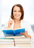 Student with stack pile of books Stock Image
