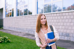 Student standing on building background. With large windows Royalty Free Stock Photography