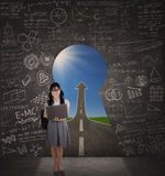 Student standing on a chance door Stock Photos
