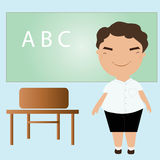 Student standing in front of a blackboard Stock Image
