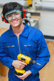 Student standing while holding a driller Stock Photography