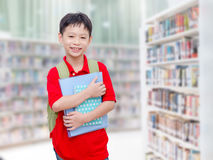 Student standing in library Stock Images