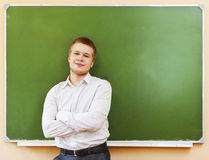 Student standing near the blackboard in the classroom Royalty Free Stock Images