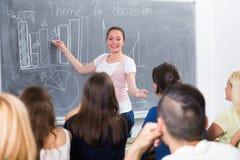 Student standing near blackboard Royalty Free Stock Photography