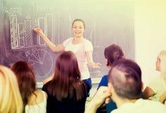 Student standing near blackboard Stock Photo