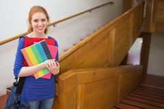 Student standing on the stairs smiling at camera Stock Photos