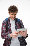 Student standing with tablet computer. Happy male student standing with tablet computer Stock Image