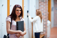 Student standing up with her binder Stock Image