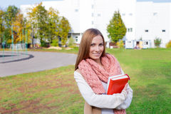 Student standing and wearing scarf. Student standing near stadium and wearing scarf royalty free stock photos