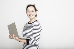 Student stands proudly and holding a notebook in her hands Stock Photo