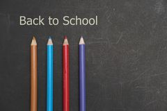 Back to school. Student stationery are on the black board Royalty Free Stock Image