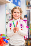 Student in stationery store buying pens. Holding them into the camera royalty free stock photo