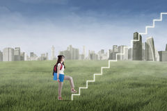 Student stepping up on stairs 1 Royalty Free Stock Images