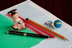 Student still-life. Still-life with the copybook and pencils Royalty Free Stock Photos