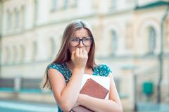Student stressed young woman biting fingernails looking away anxiously royalty free stock images