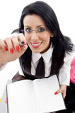 Student with study material pointing with her pen Royalty Free Stock Photography