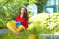Student studying on campus lawn Royalty Free Stock Photography