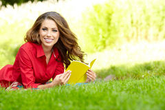 Student studying on campus lawn Royalty Free Stock Photo