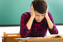 Student  studying for exam in classroom Royalty Free Stock Photo