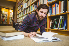 Student studying on floor in the library. At the university Royalty Free Stock Photo