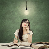 Student studying and get idea under light bulb Stock Photography