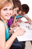 Student studying with her friends Stock Image