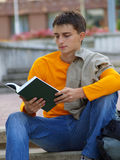Student studying with jacket through a shoulder Stock Image