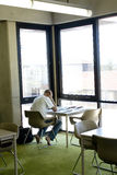 Student Studying at Library. Man studying in the corner of a library Royalty Free Stock Image