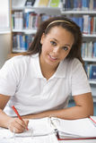 Student studying in library Stock Photography