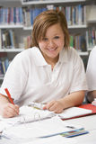 Student studying in library Royalty Free Stock Images