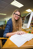 Student studying in the library with computer Stock Photos
