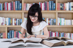 Student studying at library Stock Photo
