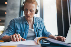 Student studying in library finding information Royalty Free Stock Images