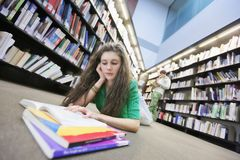 Student Studying On Library Floor Royalty Free Stock Photography