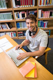 Student studying in the library with laptop Stock Photos