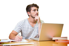 Student studying in the library with laptop Stock Image