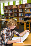 Student studying in the library Stock Photography